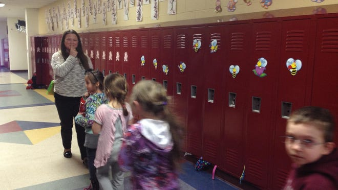 Greyhound Central Elementary teacher Amy Crittendon leads her students through the halls. Eaton Rapids Public Schools are closed today due to weather conditions.