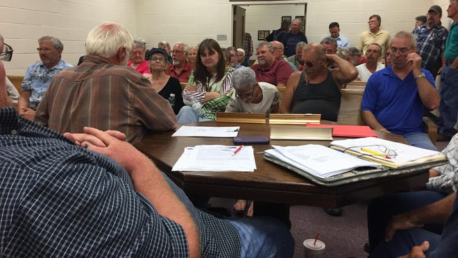 Marion County citizens listen Tuesday night as their quorum court discusses plans for a new jail. Officials will have to sell citizens on a sales tax increase to fund the project.