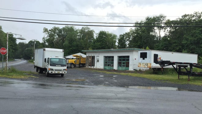 An abandoned gas station sits at the corner of Greentree Drive South and Route 9G in Hyde Park in this photo taken Aug. 11, 2015. The Town of Hyde Park, the state and Dutchess County have arranged a three-way agreement that will allow for the removal of the building.