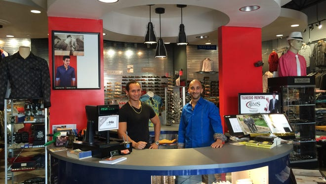 Ali Ibrahim and Abiel Cruz hope students arrival will bring boost to clothing store.