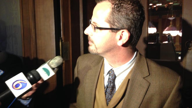 State Rep. Todd Courser talks with the media at the state Capitol Tuesday