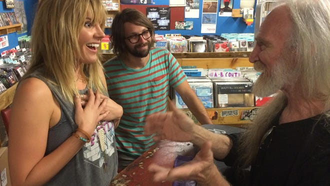 Waitsfield native Grace Potter and her guitarist, Benny Yurco of Burlington, greet Steve Laidman of Fairfax on Thursday at Pure Pop Records.