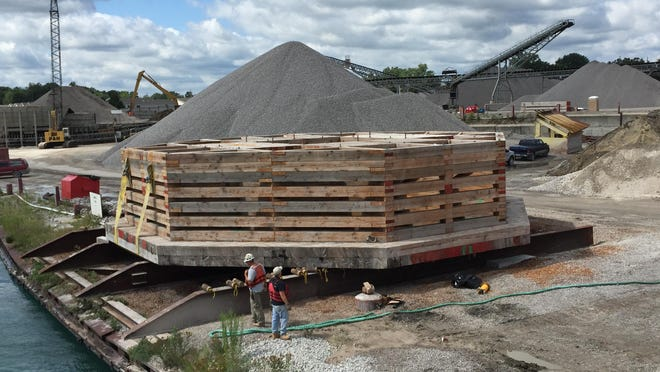 Workers prepare to launch a 285,000 pound crib into the St. Clair River in Marysville Thursday, Aug. 20, 2015. The crib will cap the end of a water intake tunnel in Worth Township for the Flint water line.