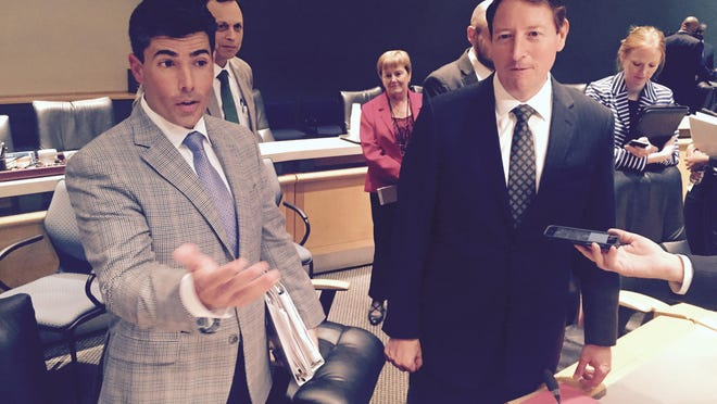 Rep. Jose Oliva, R-Hialeah, (L) and Sen. Bill Galvano, R-Bradenton, discuss congressional redistricting after a meeting of the two committee chairmen Thursday evening.