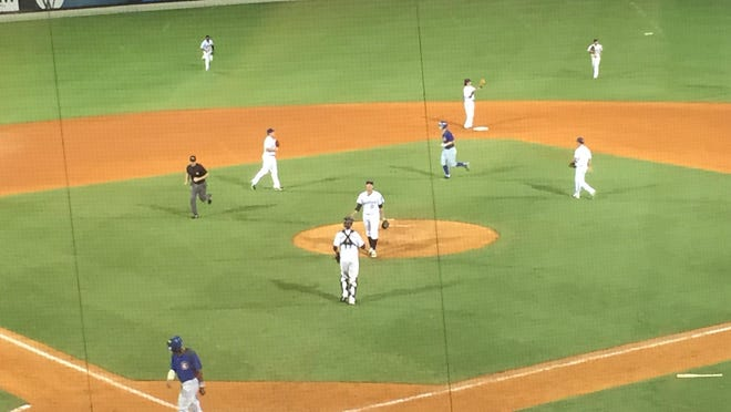 Zach Weiss is congratulated by Blue Wahoos teammates after recording his 22nd save, tying the franchise record in Thursday nights 3-1 win.