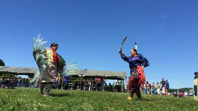 Liz Charlebois, left, of Warner, New Hampshire, and Jill Cresey-Gross of Westford, Massachusetts, dance during a Wabanaki Confederacy celebration at Shelburne Farms in August 2015.