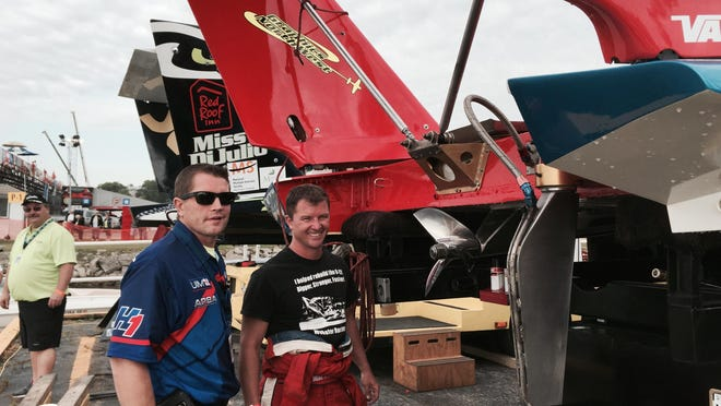 Referee Brian Hajny, left, and driver Mike Webster Saturday on the Detroit River