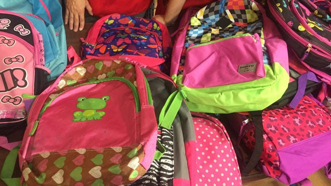 Children could choose from a variety of colorful backpacks.