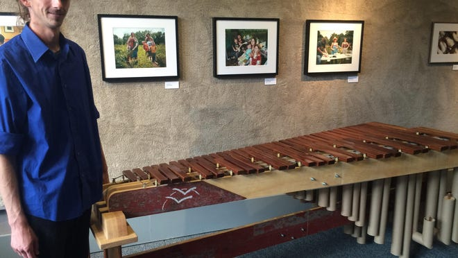 Alex Smith, owner of Jim Nugent Instrument Works, makes instruments out of reclaimed wood.
