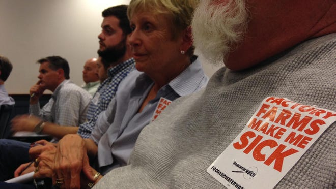 Audience members listen at a Somerset planning and zoning commission meeting about poultry house regulations earlier in 2015.