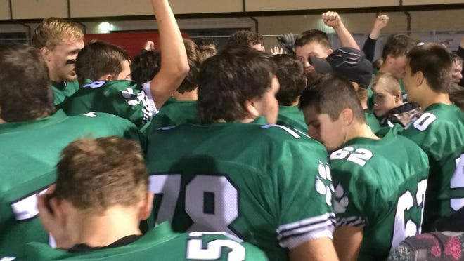 The Coleman football team celebrates its win over Gillett on Friday.