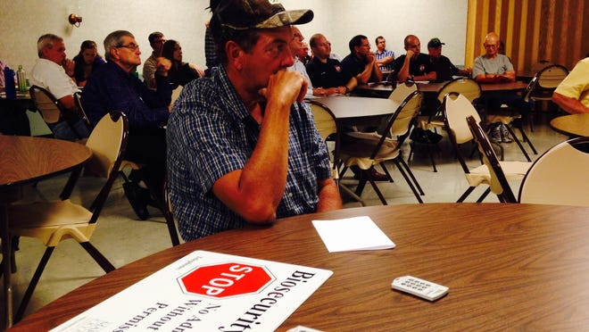 Powellville poultry grower Rick Smith listens to a presentation about avian influenza at a workshop near Pocomoke City in this file photo.