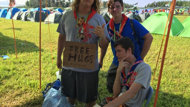 Marcello Musca, left, a Boy Scout from Naples, poses with two Scouts at the 23rd World Scout Jamboree that took place in August at Kirara-hama, Yamaguchi, Japan.