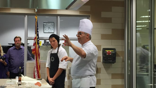 Chef Herve Glin addresses the crowd during a cooking demonstration at Thursday's Blackhawk Showdown.