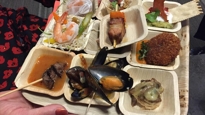 A diner at the Taste of Sioux Falls events gets ready to try a sampling of the food.