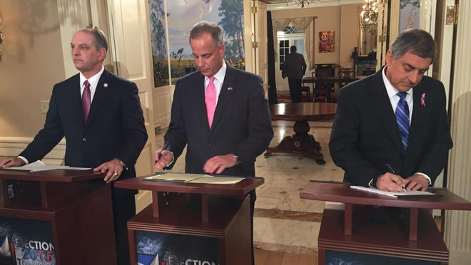 Gubernatorial candidates John Bel Edwards, Scott Angelle and Jay Dardenne prepare for a debate at the Governor's Mansion Monday.