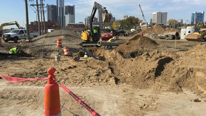 In sight of the Renaissance Center, construction crews work Tuesday on the site of the planned $65-million Orleans Landing.