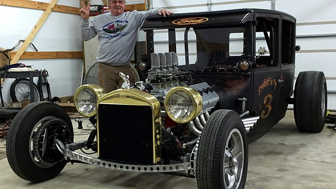 Kenneth Troutt stands with his custom hot rod, named Troutt's T, in the garage at his Lebanon home. The body came from a Ford Model T that Troutt discovered in a Georgia barn several years ago.