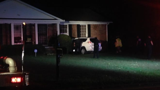 One person was injured after a vehicle hit a house on North Parkway Thursday evening.