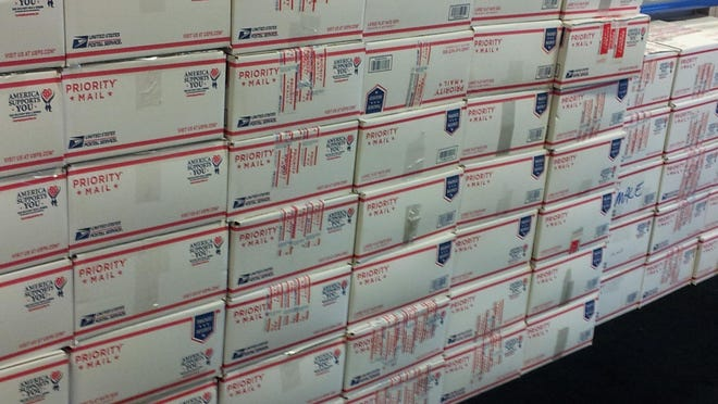There are 120 boxes packed and ready to go to troops overseas.