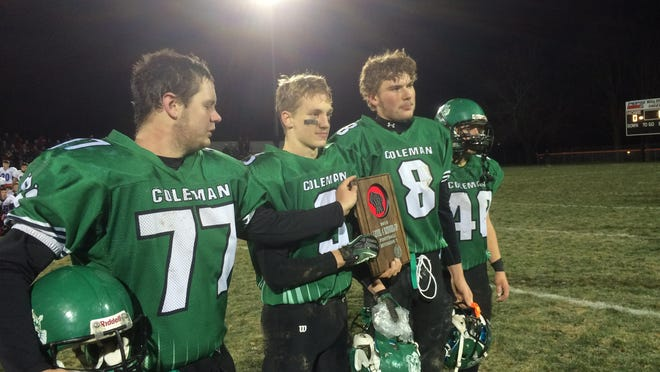 Coleman seniors (from left to right) Derek McMullen, Nicholas Sailer, Blake Margis and Jody Styczynski accept the team's WIAA Division 7 sectional runner-up plaque on Friday in Marshfield following a 35-7 loss to Pepin/Alma in a state semifinal game.