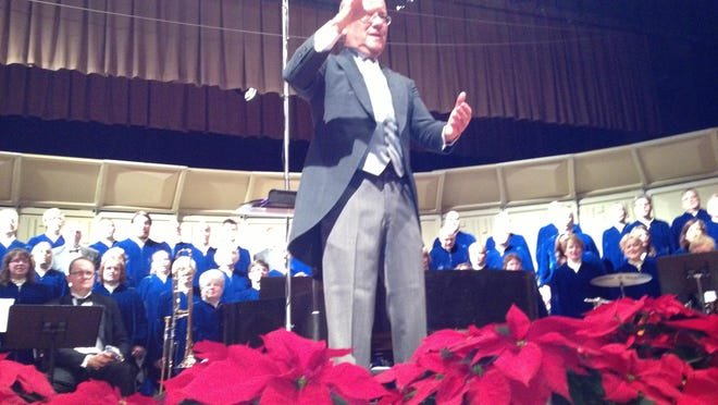 "Coshocton Community Choir Director Chuck Snyder leads the audience in a group chorus of ""Silent Night"" at the Coshocton Community Choir's annual Christmas Festival Concert in this Tribune file photo."