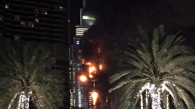 A fire runs up some 20 stories of a building in Dubai, United Arab Emirates, Thursday, Dec. 31, 2015. The fire broke out Thursday in a residential building near Dubai's massive New Year's Eve fireworks display. It was not immediately clear what caused the fire near the Burj Khalifa, the world's tallest skyscraper at 2715 feet.