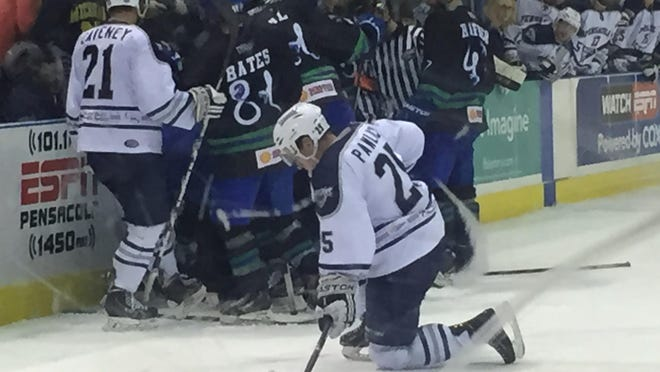 Adam Pawlick.(25) is shaken up after a hard check with less than 10 seconds left in Saturday's 4-2 win against Columbus. Several teammates rushed to his defense near the benches.