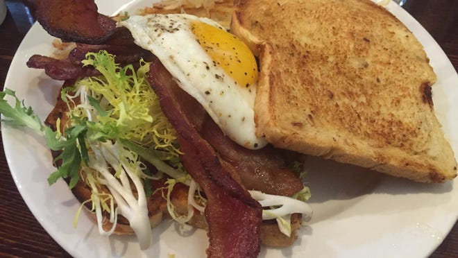 Sweet pops of tomato jam and an oozy fried egg add interest to a BLT at Crème Café and Catering in Midtown. The restaurant serves breakfast and lunch from 8 a.m. to 2 p.m. daily except for Mondays.