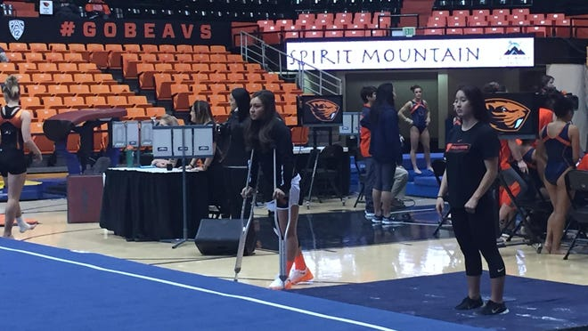 Oregon State gymnast Erika Aufiero (left), who suffered a season-ending knee injury in practice Tuesday, before Sunday's meet against Auburn.