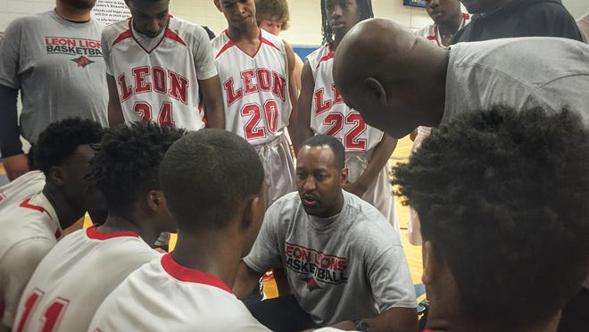 Leon head coach Rick Davis talks to his team during the MLK Inspire Classic at Rickards on Monday.