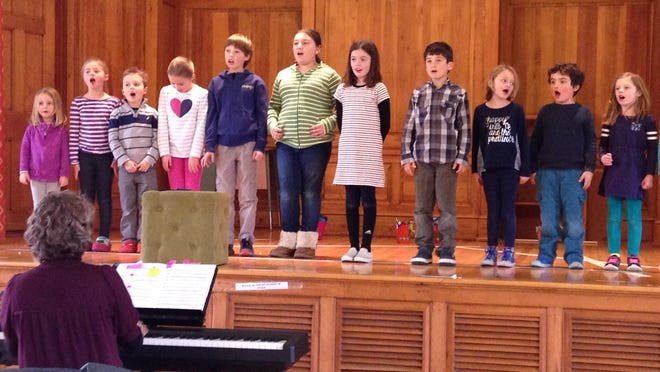 "Students rehearse at the Shelburne Town Hall with music teacher Helen Weston for ""Sing Me a Story,"" a musical that takes students and audiences into the world of reading and storytelling."