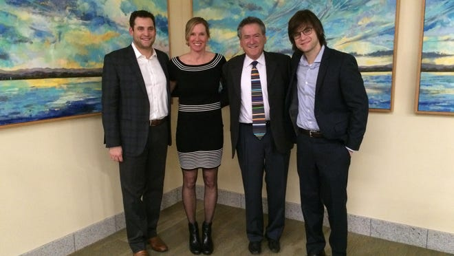 State Sen. Michael Sirotkin, D-Chittenden, third from left, poses on Jan. 29 with his sons Jacob, left, and Jesse, right, along with Burlington artist Katharine Montstream at the new State Office Complex in Waterbury. A panel of paintings by Montstream were unveiled in honor of Sirotkin's late wife, Sen. Sally Fox. The paintings adorn the walls of the Senator Sally Fox Conference Center.