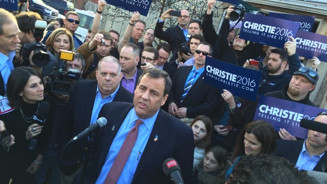 New Jersey Gov. and presidential candidate Chris Christie may have scored points with New Hampshire primary voters based on his performance at the GOP presidential debate on Saturday night. Here, Christie is with Maryland Gov. Larry Hogan (left), after a campaign event at Shooter's Pub in Exeter, New Hampshire, on Sunday, March 7, 2016 (Thomas P. Costello/Asbury Park Press)