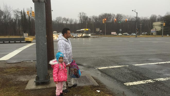Francisco Gutierrez, who lives nearby, stands at the corner of Route 46 east and New Road in Parsippany, preparing to cross with his daughter. A pedestrian was struck by a car and seriously injured there less than 24 hours earlier.