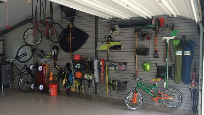 Todd Carter of Tailored Living featuring Premier Garage added wall storage systems and flooring to transform a garage into a workout room.