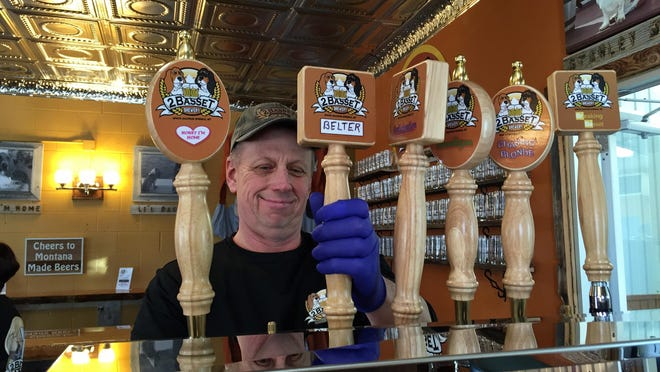 White Sulphur Springs football coach Barry Hedrich pours a sample of Belter, a Scottish ale, at his new 2 Basset Brewery.