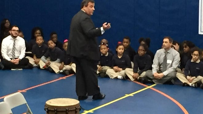 The state constitution has a provision that disqualifies Gov. Chris Christie -- seen here students and staff at Alexander Street Elementary School in Newak on Monday -- from running in the 2017 gubernatorial election. But the framers said nothing that would prevent Christie from competing again in 2021. (Bob Jordan/iPhone)