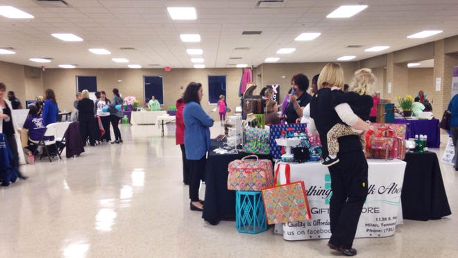 Milan women are educated about health issues at the ACHIEVE Team's women's health expo Thursday night.