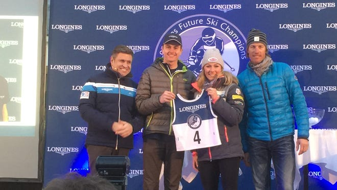 Waitsfield's Ben Ritchie, center left, is presented with his bib number by Mikaela Skiffrin, center right, before Tuesday's Longines Future Ski Champions event in St. Moritz, Switzerland.