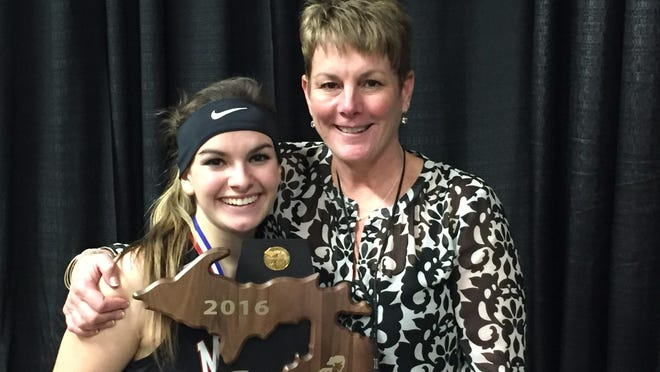 """Marshall junior Jill Konkle, the coach's daughter, who scored a team-high 13 points in the final, with her mom, Marshall coach Sal Konkle, and their shared state trophy. """"This is a dream come true,"""" Jill Konkle said."""