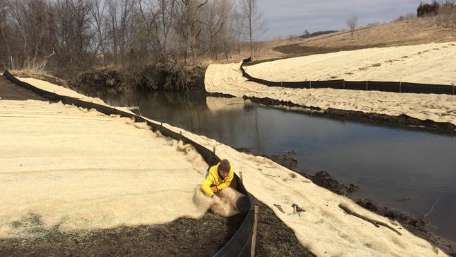 Students at Drake University and Southeast Polk High School and Metro Waste Authority are working to fight erosion on Camp Creek.