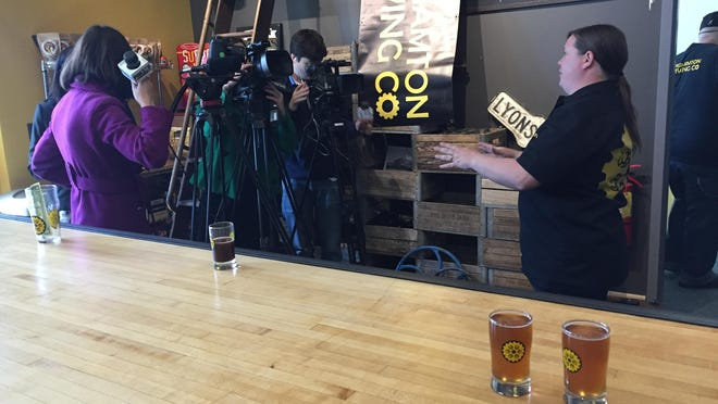 Binghamton Brewing Co. co-founder Kristen Lyons prepares for interviews Wednesday with samples on the bar. The Johnson City establishment was host to state officials' announcement of a task force's recommendations of changes in state liquor law designed to stimulate New York's craft beverage industry.