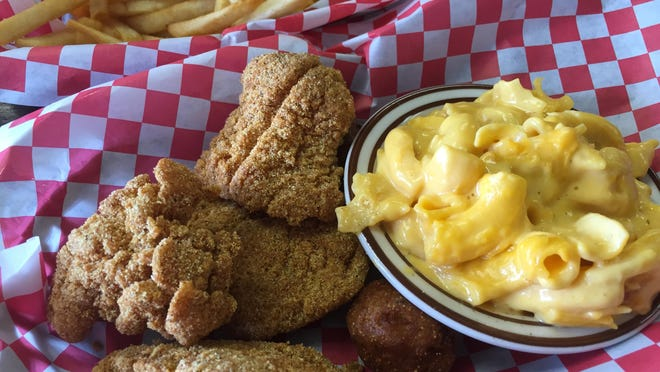 The catfish basket at M & M's Southern Café comes with one side (here, luscious macaroni and cheese). A couple of hushpuppies are tucked into the basket.