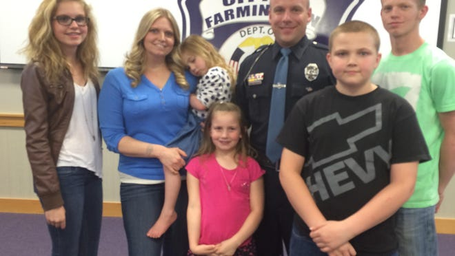 Scott Brown, Farmington's 2015 Public Safety Officer of the year, poses with his family: Wife, Billie, and kids Dylan, Breanna, Kaleb, Izabella and Nevaeh.