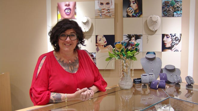 Michelle Turner Ganz stands behind a counter at Dean's Jewelry in Coshocton. Her grandfather's generosity and dedication to Coshocton continues to inspire Turner Ganz and the family, who are following in Dean's footsteps of giving back, she said.