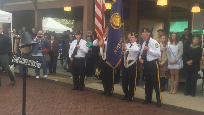 The color guard posts the colors as the opening ceremony for the Farmington Farmers & Artisans Market kicks off.