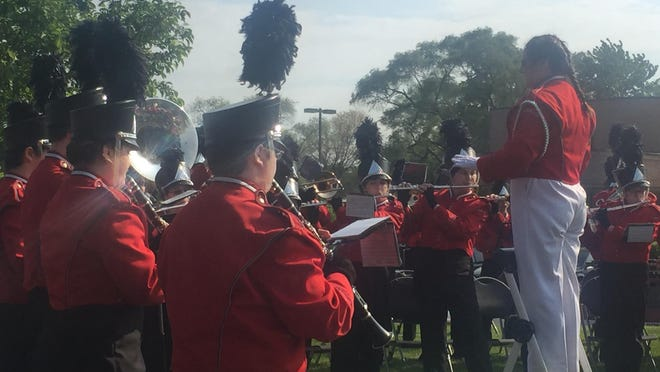 The Franklin High School band plans the service hymns for the branches of the U.S. military at Saturday's Memorial Day ceremony.