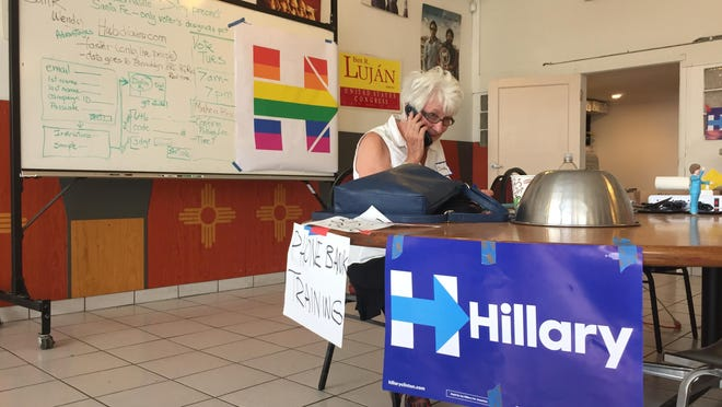 Retired historian Sandy Schackel, 74, of Santa Fe, New Mexico, makes phone calls in support of Democratic presidential candidate, Hillary Clinton, at local campaign headquarters in Santa Fe, N.M., on Monday. Clinton secured enough delegate commitments Monday to become the presumptive Democratic nominee for president, hours before New Mexico voters go to the primary polls.