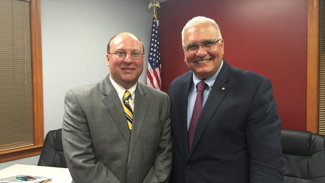 Matt Dowling, left, with Union Mayor Larry Solomon after the Union City Commission voted to hire Dowling as city administrator.